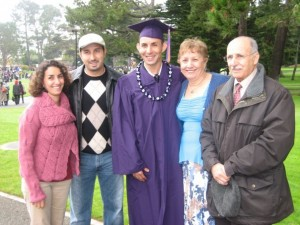 Mehdi graduates from SFSU surrounded by his family.