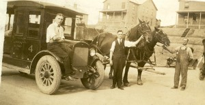 Union Supply Co. transport, both auto and horse. Wilson Gordon is center with tie. The Gordon home is center back.