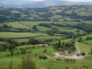 Farm and hill country near Llanfyllin  (photo: Oliver Dixon, geograph.org.uk)