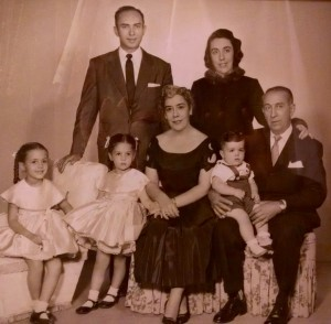 Paula's family. (Front, from left) sister Sandra, Paula, Grandma Maria Natalia, brother Victor, Grandpa Pablo. (Back, from left): Paula's father Manual and mother Marguerite. Paula's mother made the sisters' dresses.