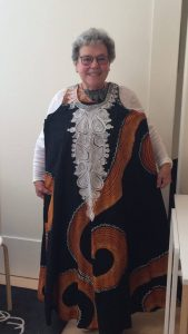 Jean holding up a dress made out of dashiki wear