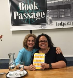 Julie (with a friend) in 2016 at a book signing session with the book she wrote