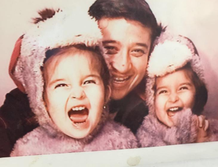 Rosendo with his twin daughters when they were toddlers.